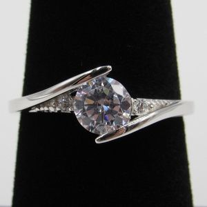Sterling Silver Between Clear CZ Diamond Band Ring